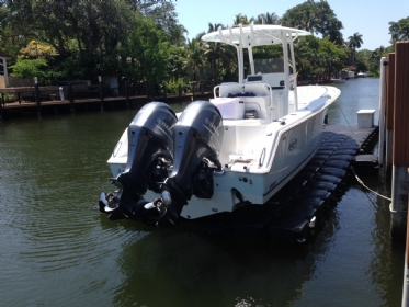 floating boat lift for a boat