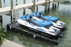 Two jet skis docked on a floating double PWC lift: Jet Dock